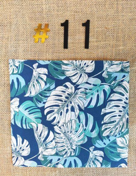 Tissu motifs ramages feuilles écrus & verts fond bleu pour Pochette personnalisable par l'échoppe de Nine