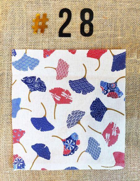 Tissu motif feuilles de Ginkgo bleu & rouges fond écru pour Pochette personnalisable par l'échoppe de Nine