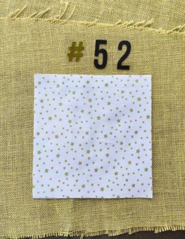 Tissu motifs étoiles dorées fond blanc thème Noël pour Pochette personnalisable par l'échoppe de Nine