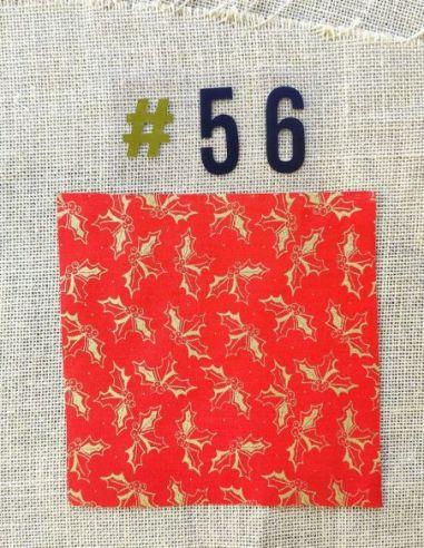 Tissu motifs houx dorés fond rouge esprit de Noël pour Lingettes personnalisablespar l'échoppe de Nine